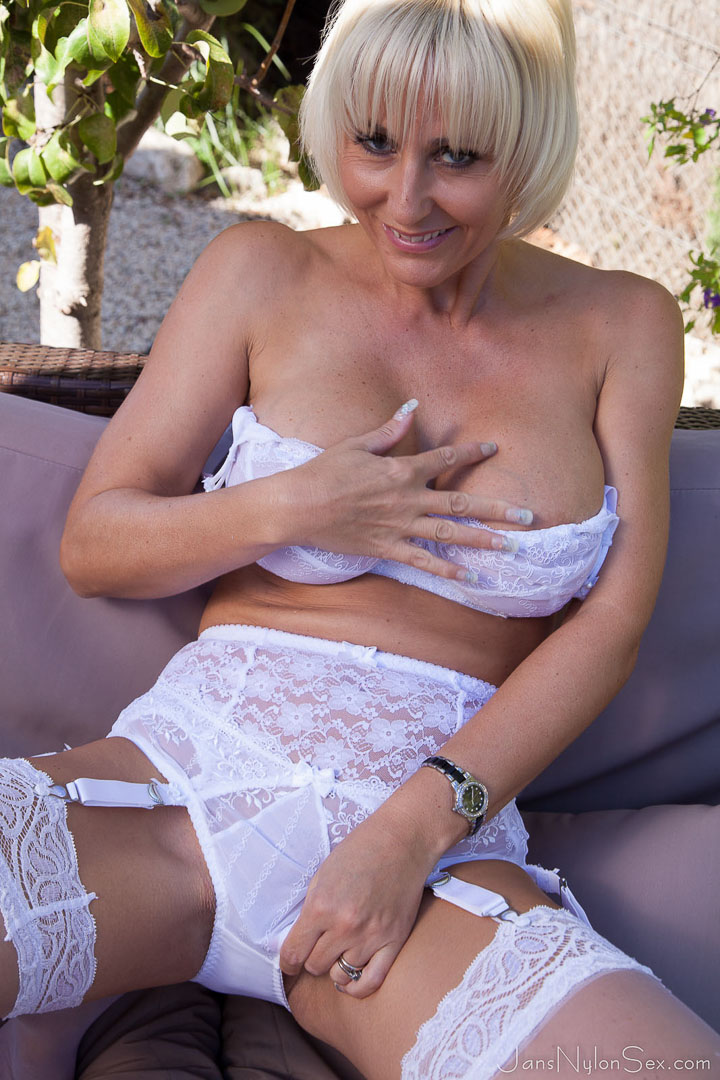 Mature lady in lingerie slaps and tugs cock 8