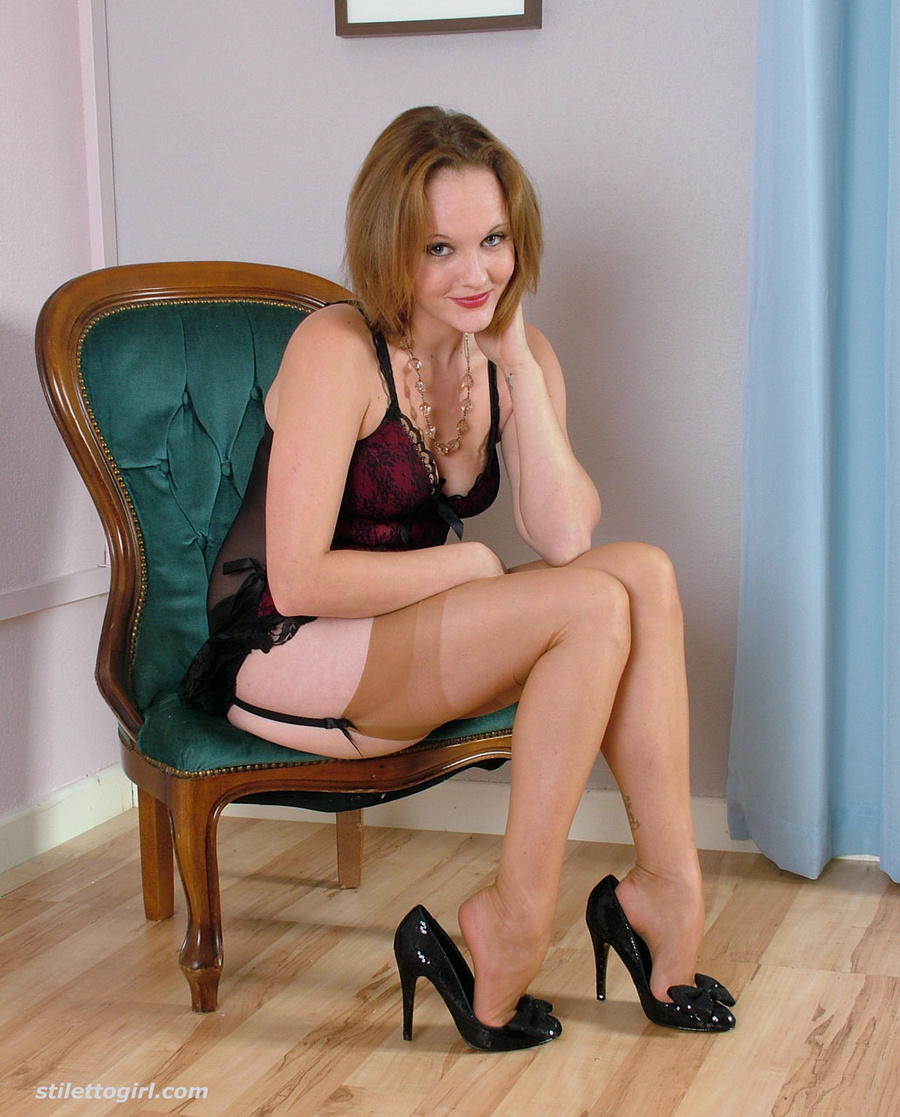 is wearing silky nylon stockings and black high heels | Free Sexy High ...