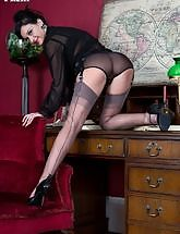 Cassie is wearing high heels and sheer grey FF nylons